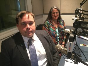 Ann Kloeckner and Daniel Turczan of Legal Aid Works in front of microphones at a radio station, during a recent appearance on Town Talk, where they previewed an upcoming Fair Housing Forum and discussed local housing issues.